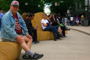 People seated at Urban Reef - winning entry in the 2014 Robson Redux design competition.