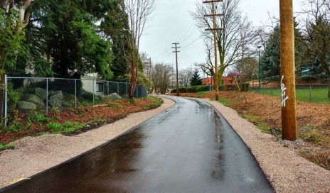 With paving of the temporary path complete, the Arbutus Greenway veers toward the community gardens at 6th. Photo: Naomi Reichstein