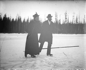 Man and woman skating on Trout Lake