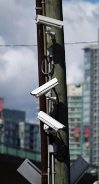 Photo of three surveillance cameras on a utility pole in downtown Vancouver.